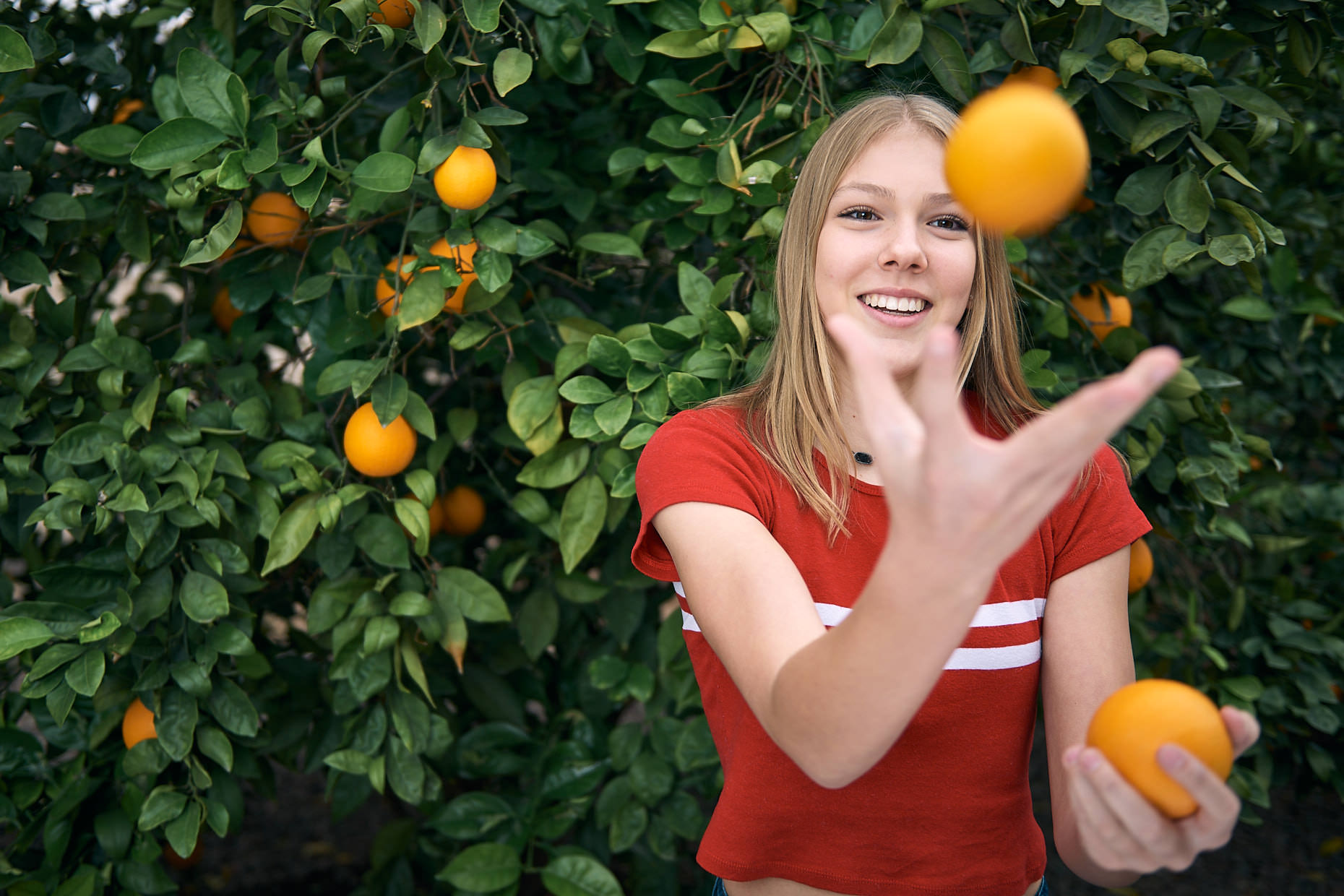 Jason Tracy - Advertising Photographer Kansas City - Young Girl with Orange Tree