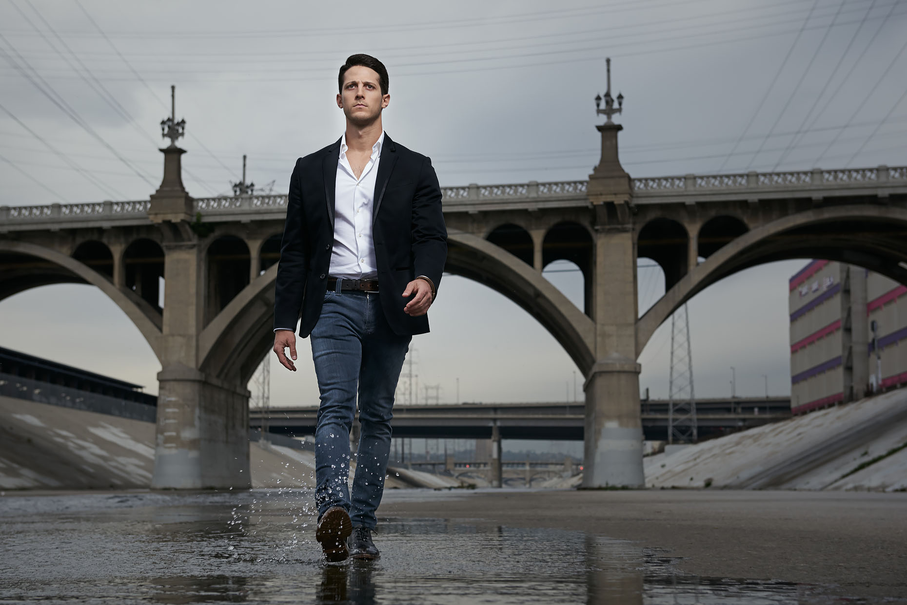 Ryan Alexander walking in the LA river. Los Angeles, CA.