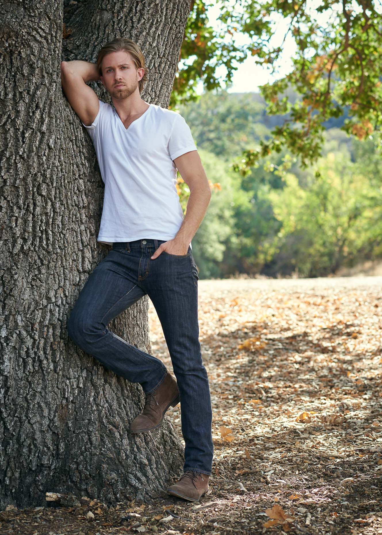 Man leaning against a tree in Malibu, CA.